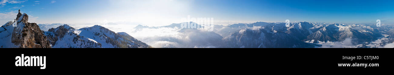 South Germany, Upper Bavaria, Bayrischzell, View of small church with alps from Wendelstein mountain - Stock Image