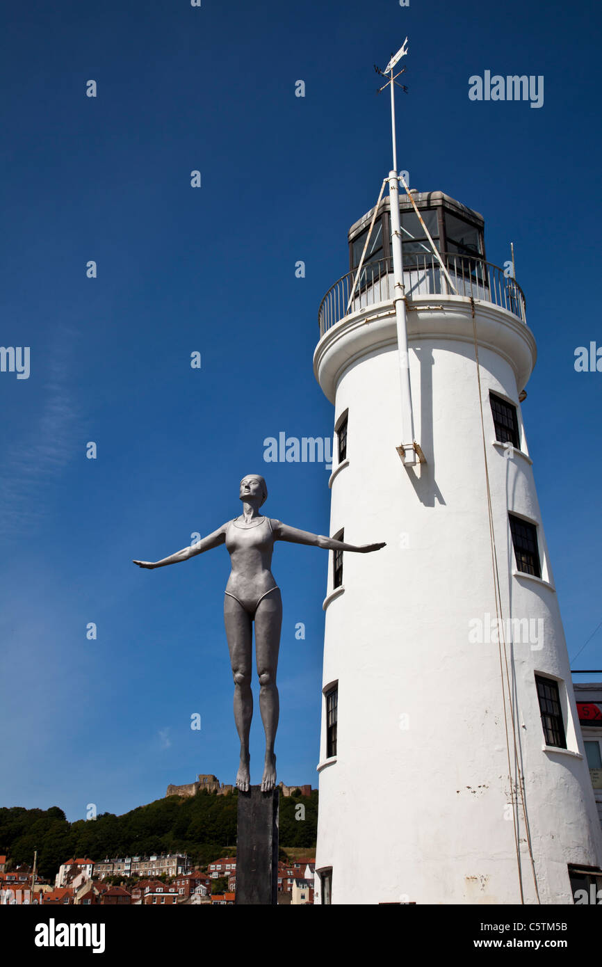 The Lighthouse and diving belle sculpture, Scarborough Harbour, North Yorkshire - Stock Image