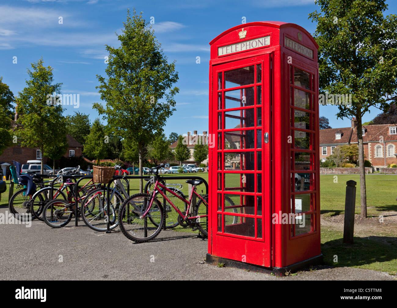 Red telephone box with bicycles Salisbury Wiltshire England UK GB EU Europe - Stock Image