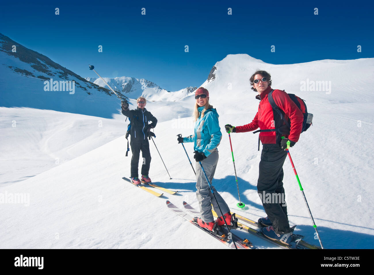 Austria, Salzbzrger Land, Altenmarkt, Zauchensee, Three persons cross country skiing in mountains - Stock Image