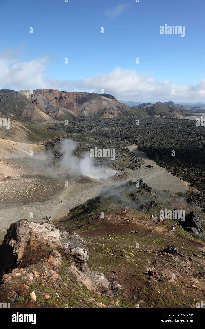 Old Lava Flow with Steam Rising from Fumeroles on the Laugavegur Hiking Trail Near Landmannalaugar Fjallabak Area Stock Photo