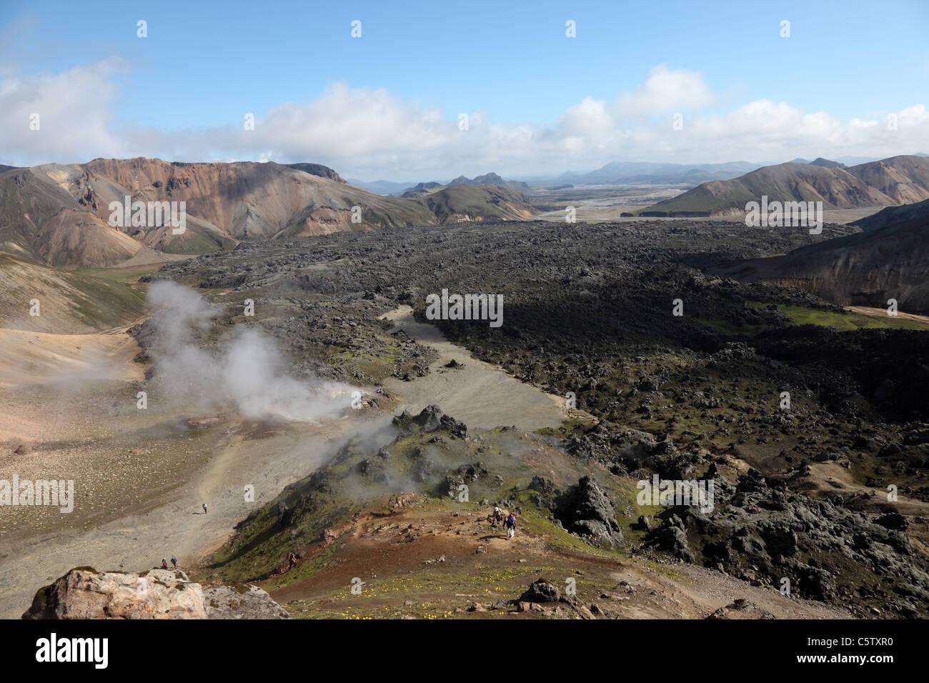 Old Lava Flow with Steam Rising from Fumeroles on the Laugavegur Hiking Trail Near Landmannalaugar Fjallabak Area - Stock Image