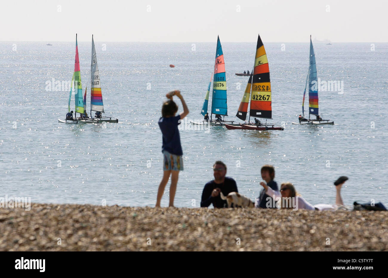 Brighton beach on a hot summers day. Picture by James Boardman - Stock Image
