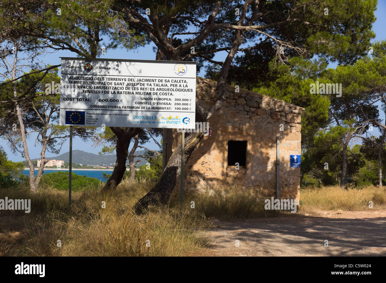 Ibiza, Balearics, Spain - Sa Caleta. Notice of European and other funding to restore military ruins as a museum - Stock Image