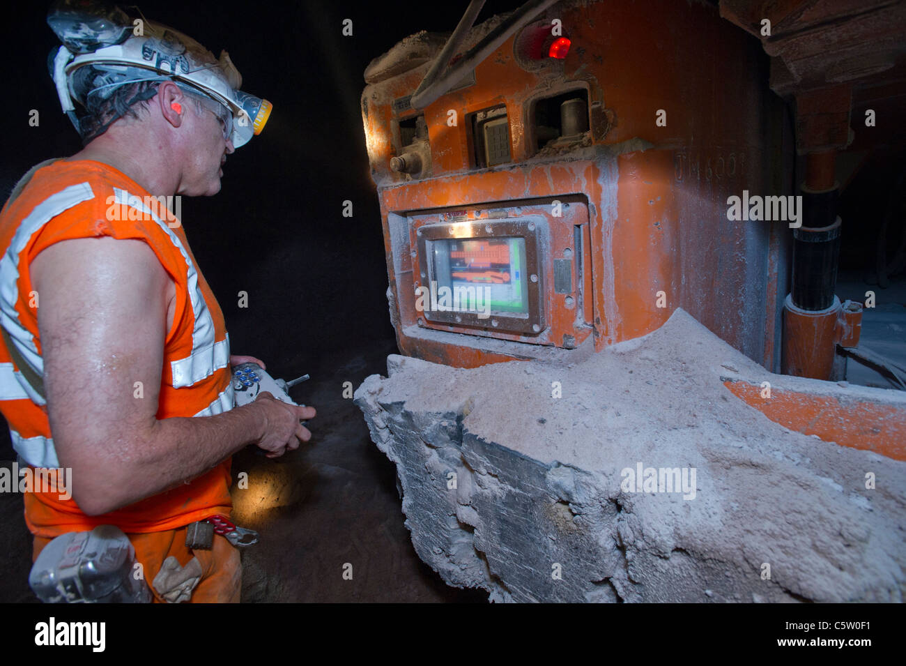 A continuous miner in Boulby Potash mine is checked for rate of production - Stock Image