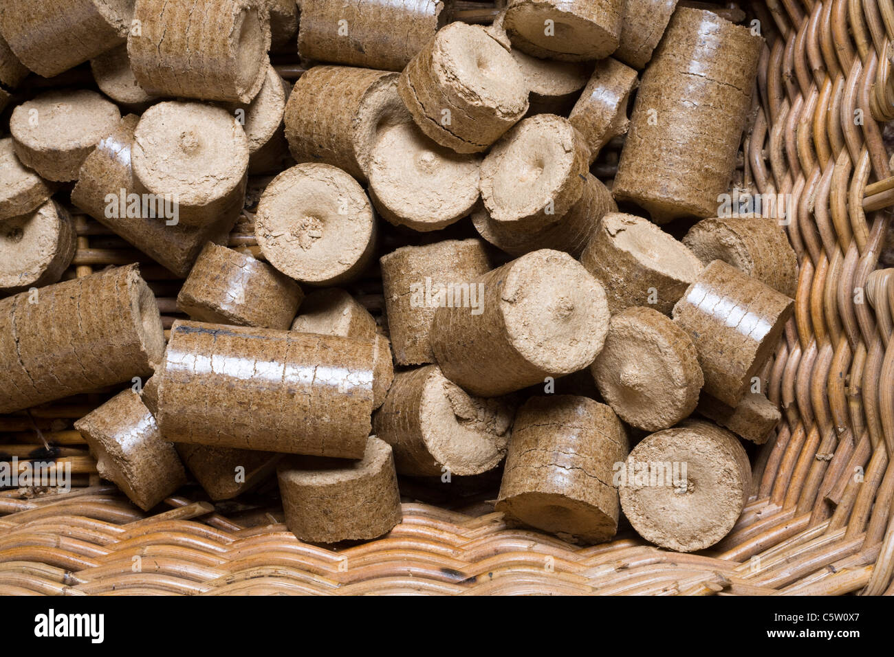 Compressed wood chip and sawdust pellets in a log basket
