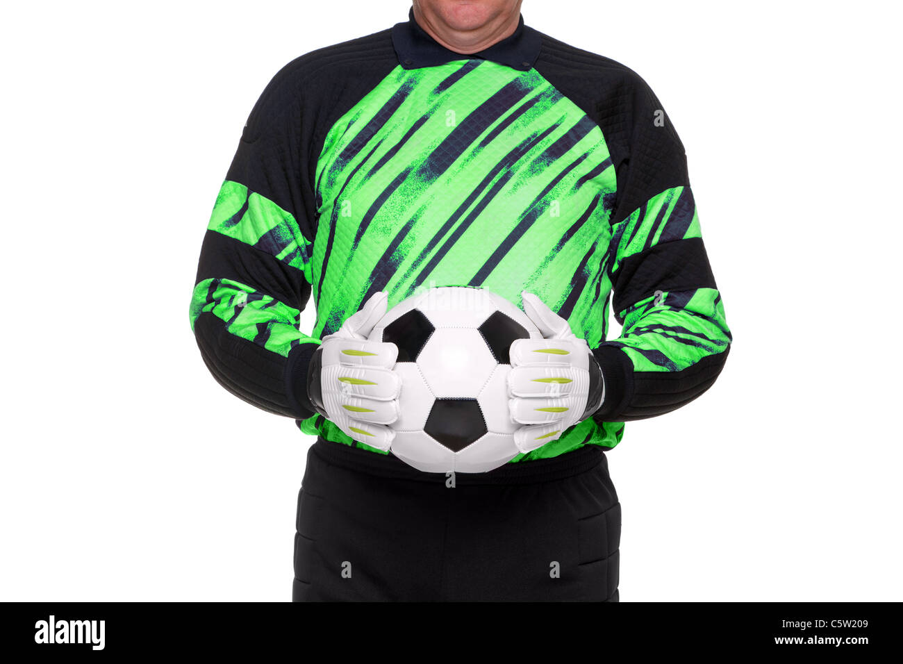 Photo of a football or soccer goalkeeper wearing gloves and holding a ball, isolated on a white background. - Stock Image
