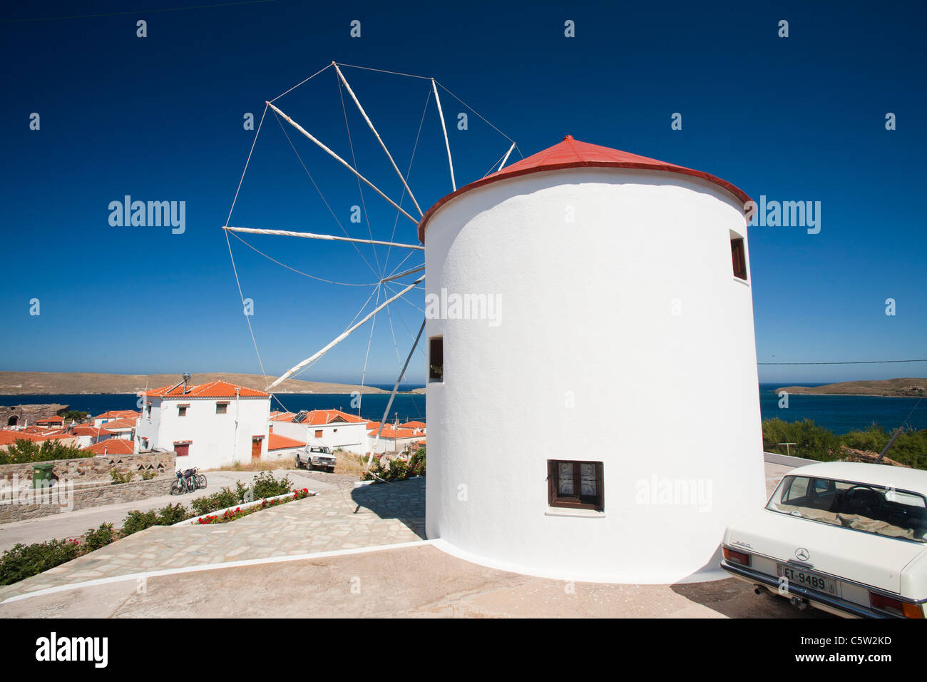A traditional cloth sailed windmill converted into a house in Sigri, on Lesbos, Greece. - Stock Image