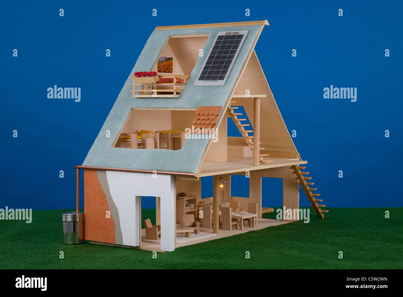 Dolls' house with solar cells on roof - Stock Image