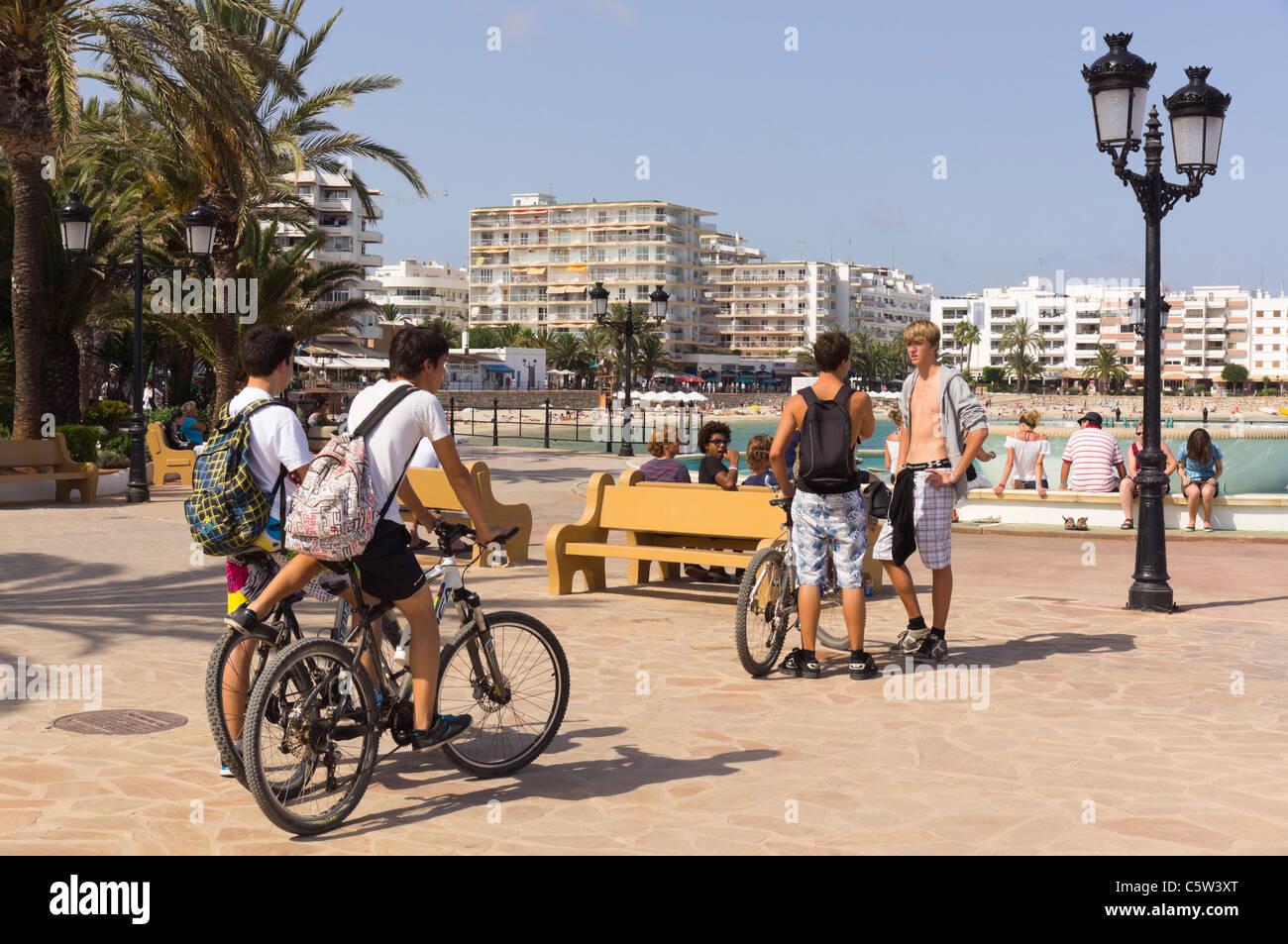 Ibiza, Balearics, Spain - Santa Eularia, beach resort on the east coast. Promenade with cyclists. - Stock Image