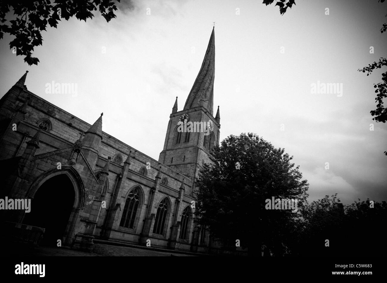 Black and white picture of Chesterfield Parish Church with crooked spire - Stock Image