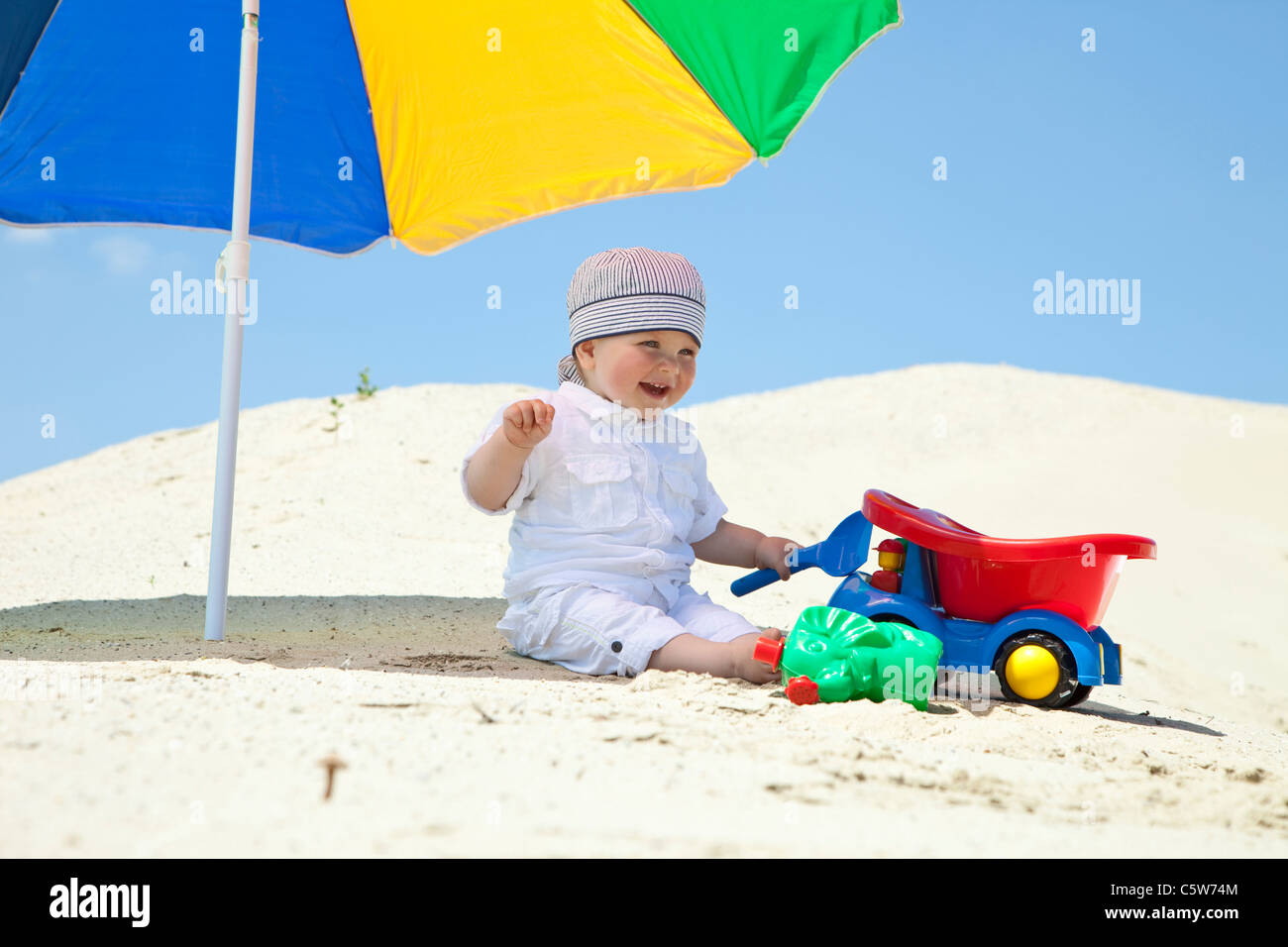 Germany, baby boy (9 months) playing on beach - Stock Image