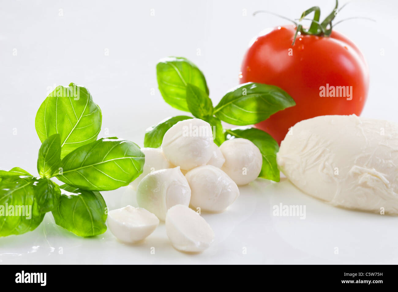 Mozzarella cheese and basil leaves - Stock Image