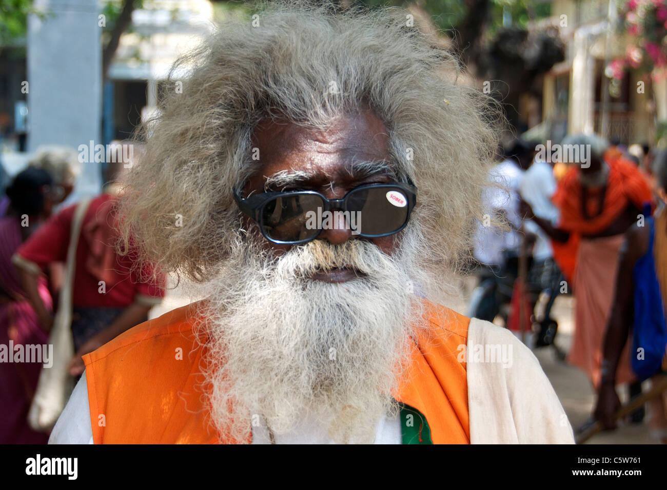 Portrait sadhu in dark glasses Sri Ramana Ashram Tiruvannamalai Tamil Nadu South India - Stock Image