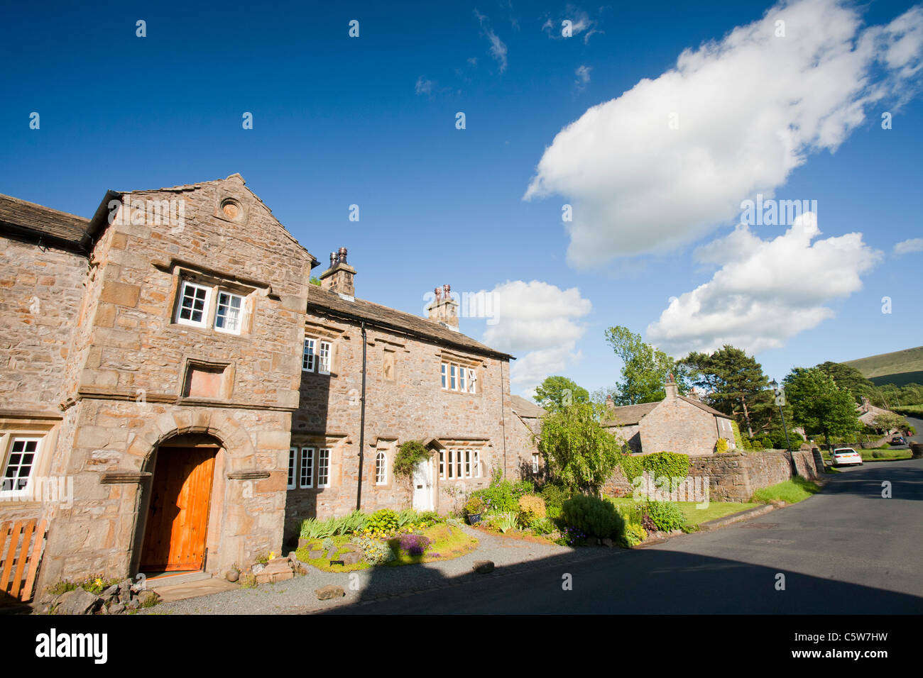 The pretty, Feudal village of Downham, nestling beneath Pendle Hill in the Ribble Valley, Lancashire, UK, - Stock Image