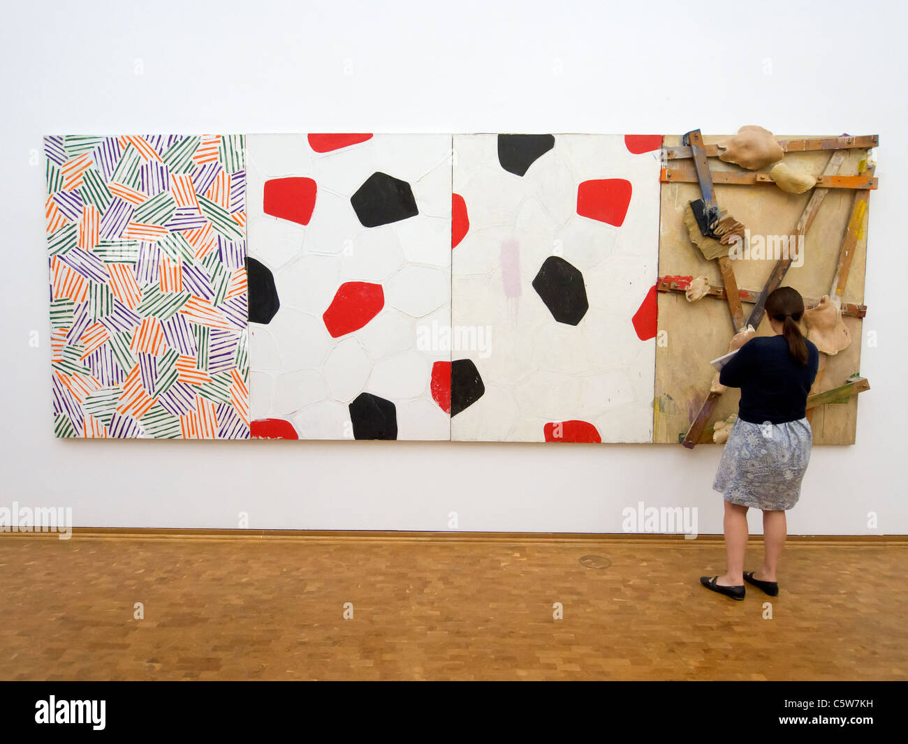 Woman looking at Untitled painting by Jasper Johns on display at Museum Ludwig in Cologne Germany - Stock Image