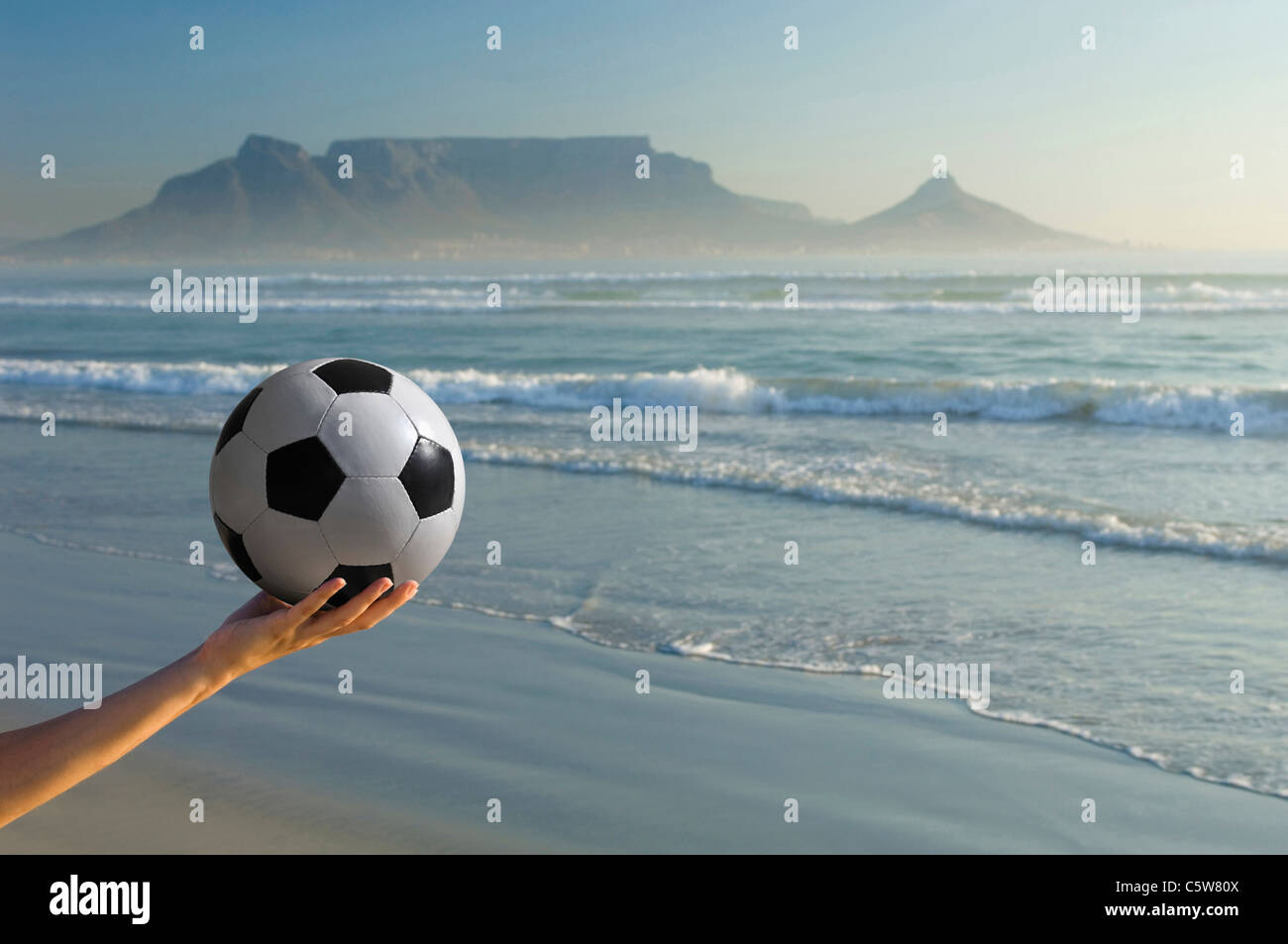 Africa, South Africa, Kapstadt, Person holding soccer ball, close-up - Stock Image