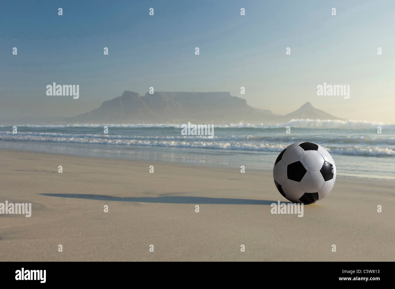 Africa, South Africa, Kapstadt, Soccer ball on beach - Stock Image