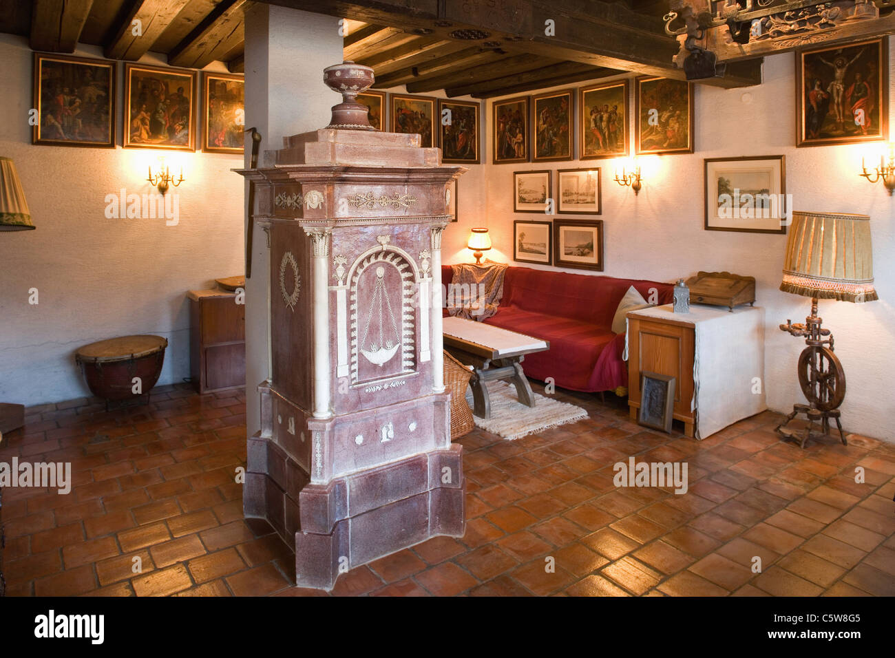 Austria, Lower Austria, Historic room with tiled stove - Stock Image