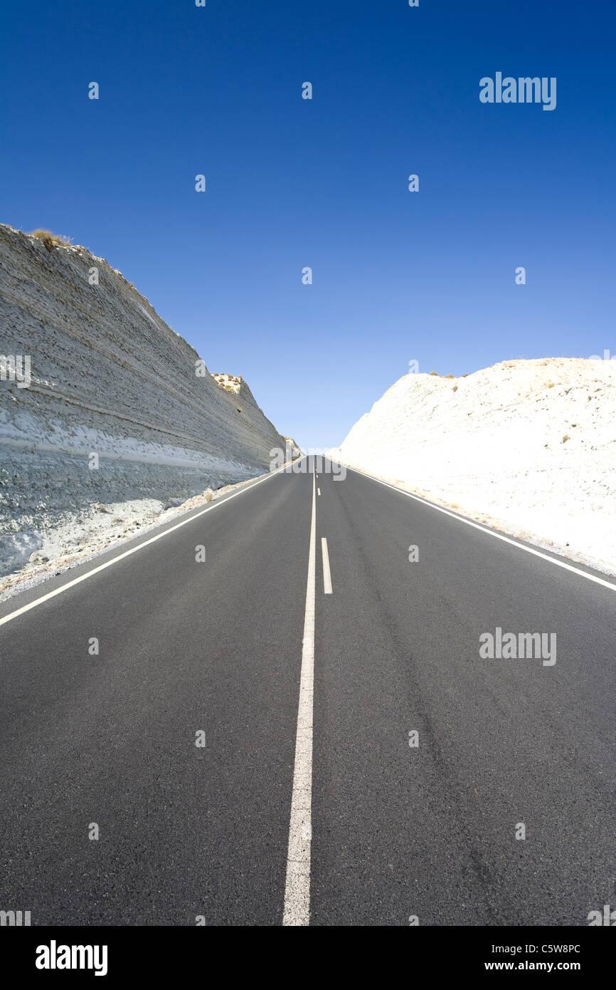 Spain, Granada, View of highway passing through calcareous rock - Stock Image