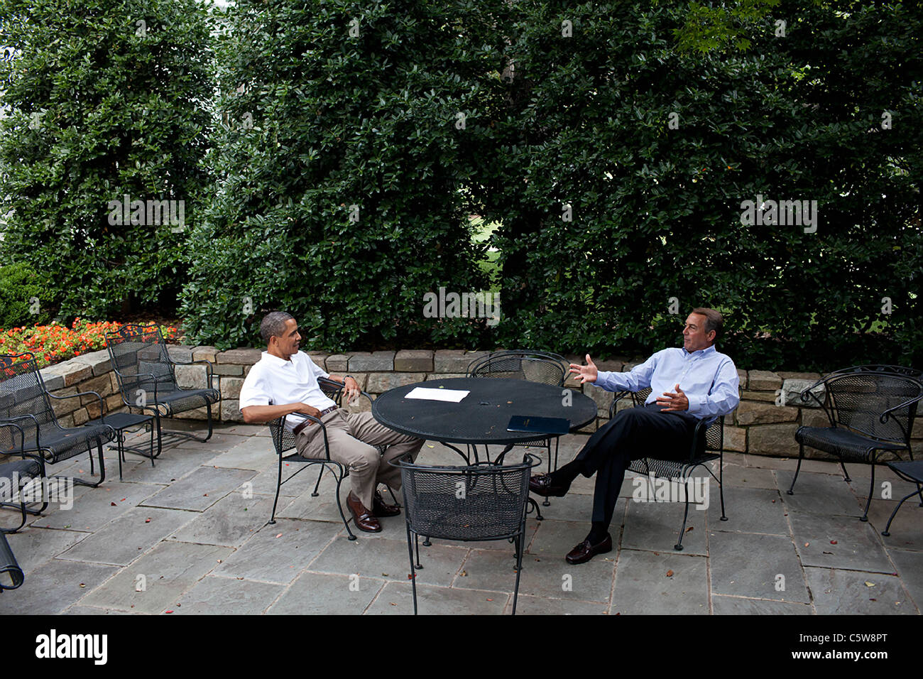 President Barack Obama meets with Speaker of the House John Boehner on the patio near the Oval Office, Sunday, July - Stock Image