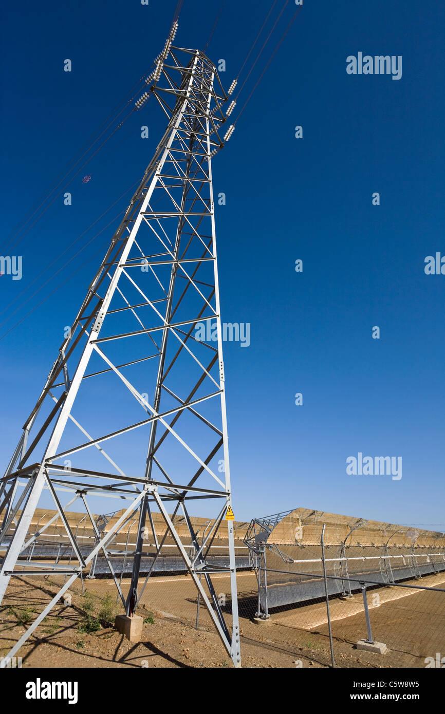 Spain, Los Milanes, Electricity pylon at solar power plant - Stock Image