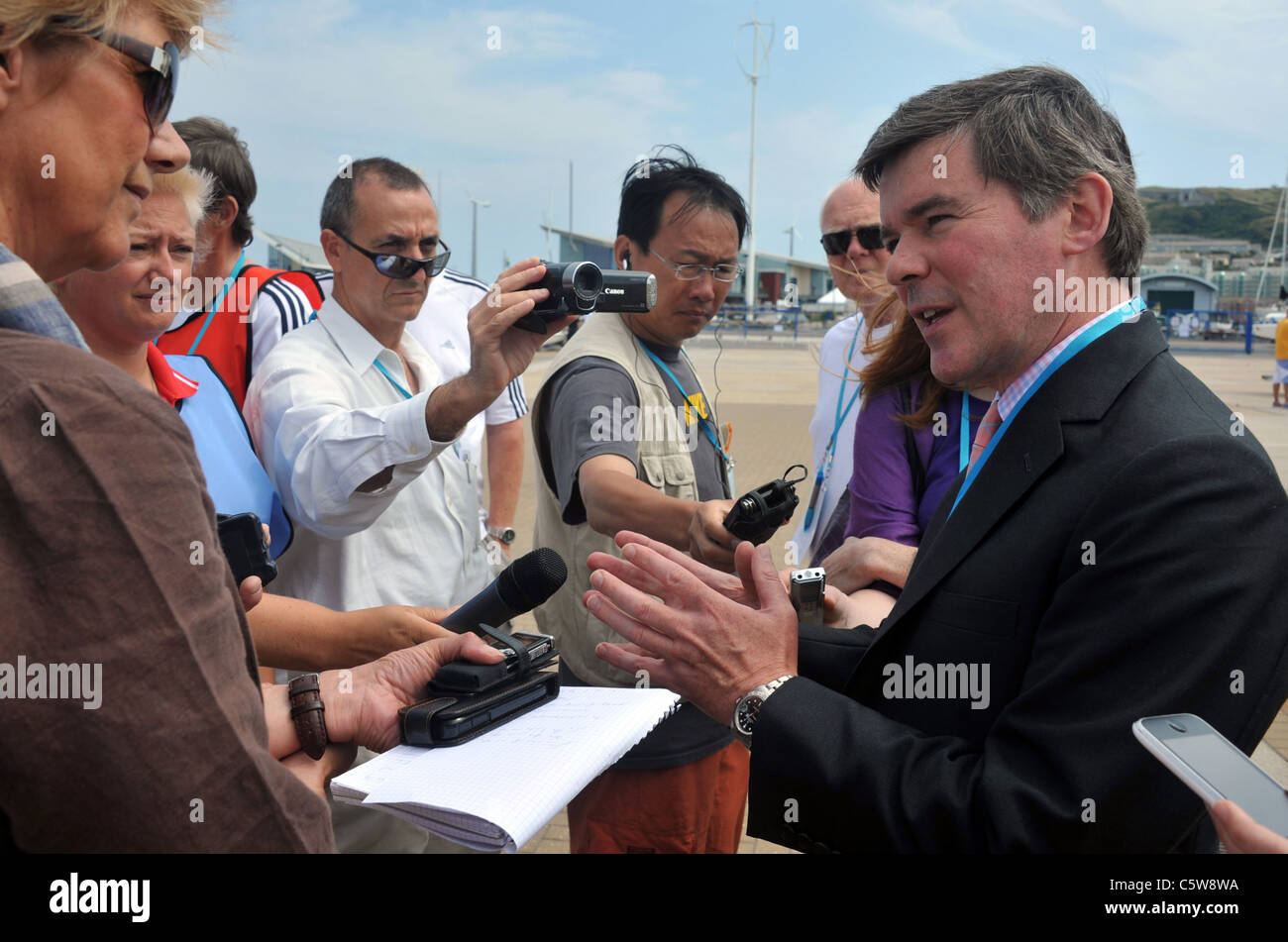 UK, Sports Minister Hugh Robertson visiting the Olympic sailing test event at the Weymouth and Portland National - Stock Image