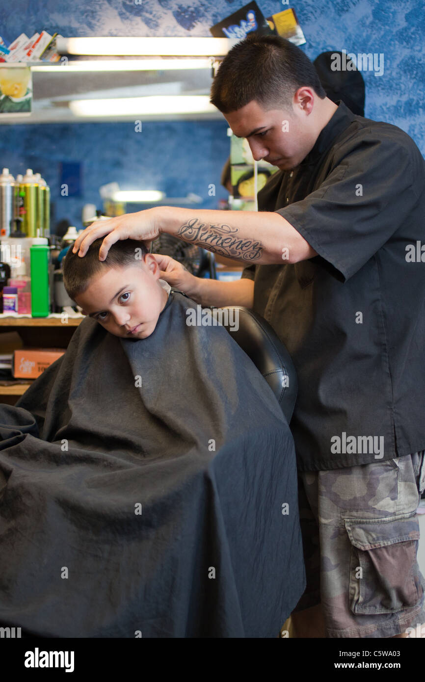 6 Year Old Boy At The Barber Shop Getting A Hair Cut Stock Photo