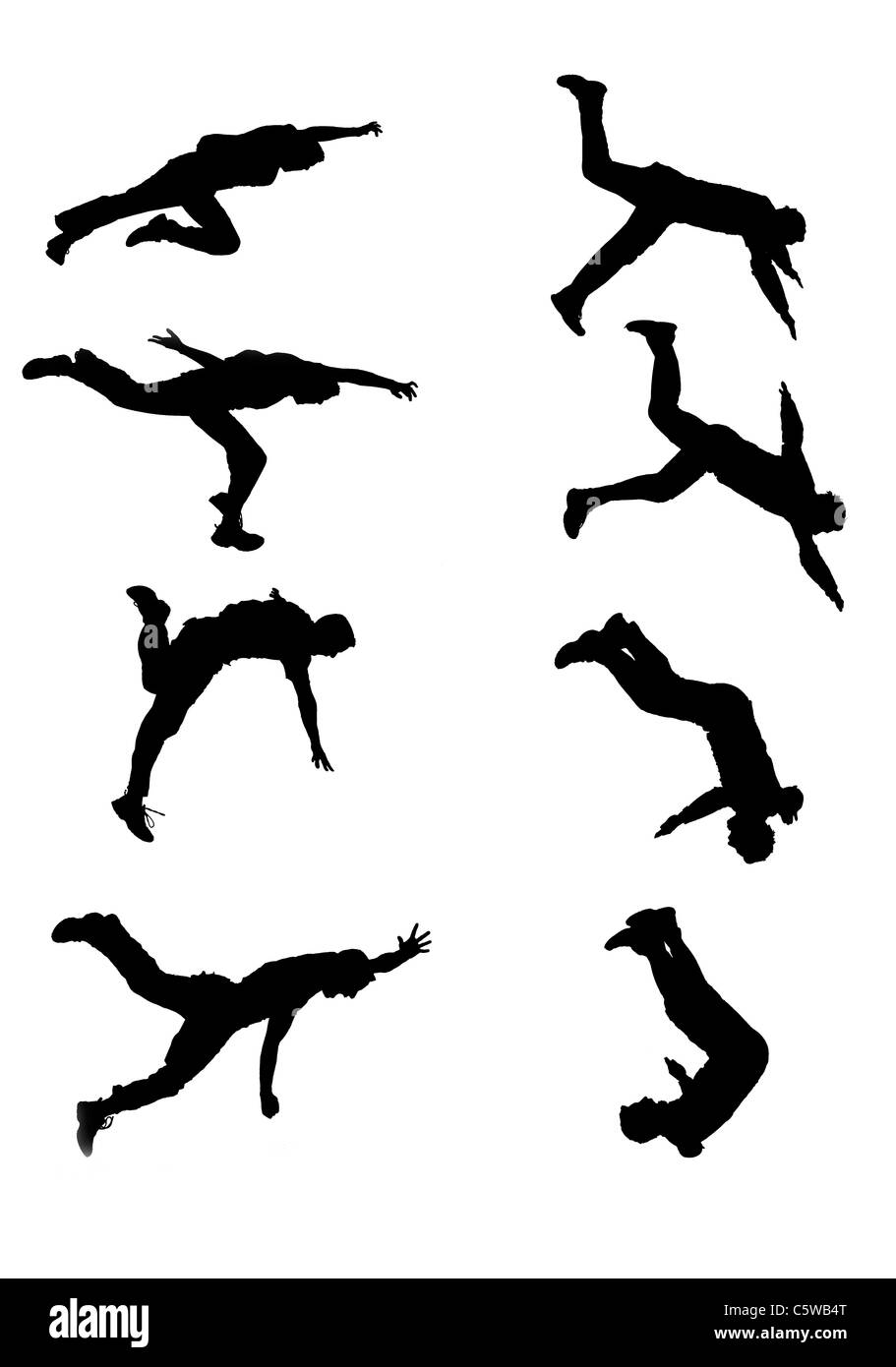 Silhouettes made from photos of two stuntmen at different stages of jumps. Each vertical set is one jump. - Stock Image