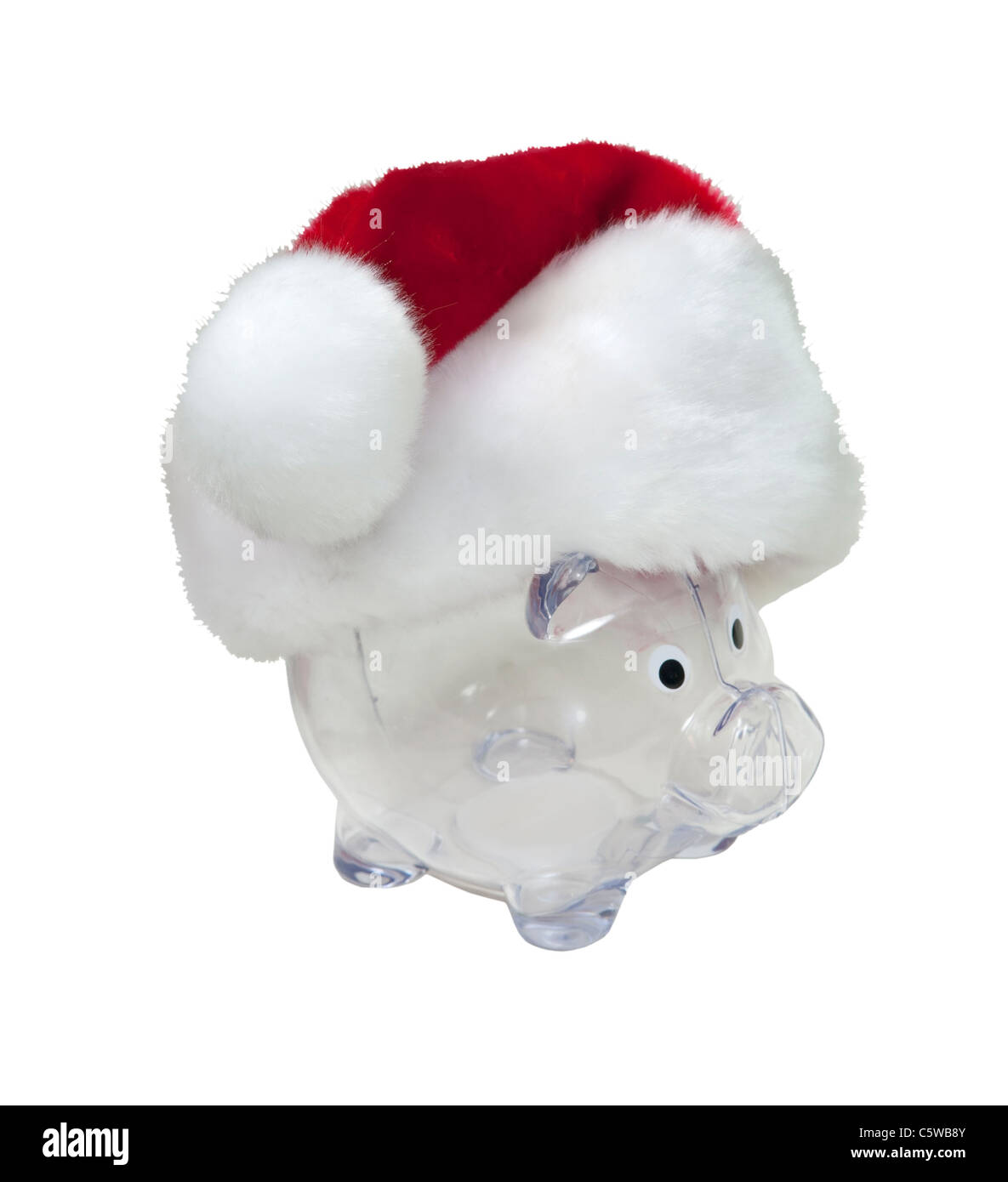 Santa funds shown by a traditional red with white trim Santa hat on a piggy bank for the holidays - path included - Stock Image