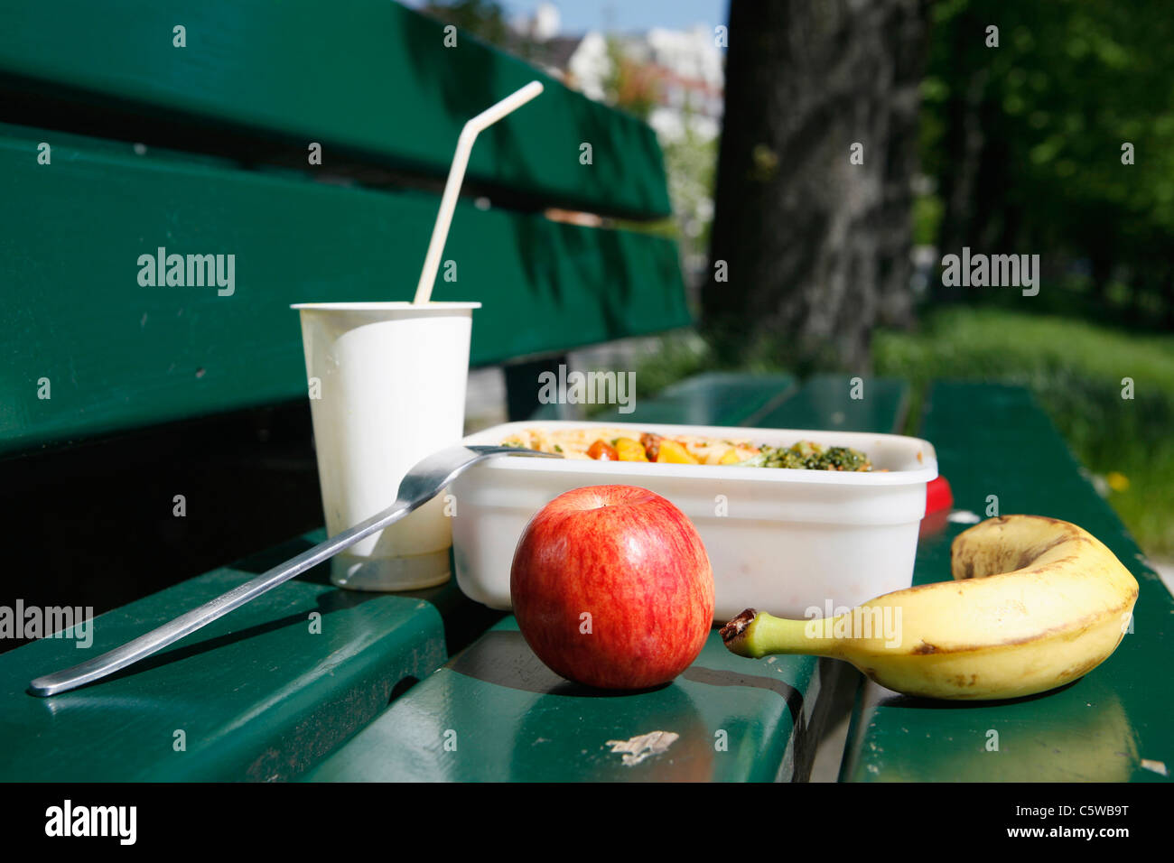 Food on park bench, close-up - Stock Image