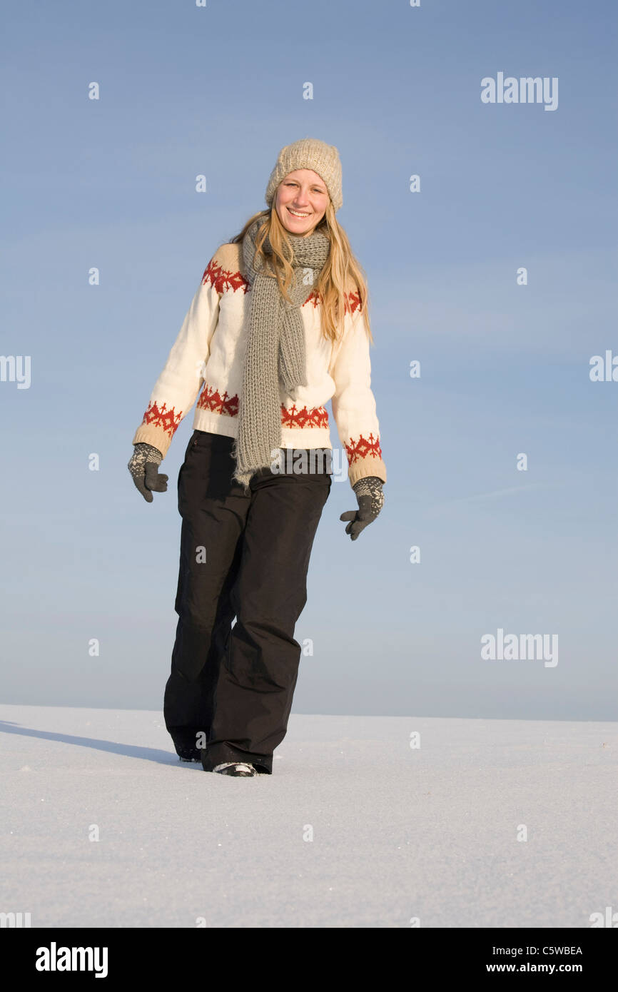 Germany, Bavaria, Munich, Young woman in snowy landscape Stock Photo