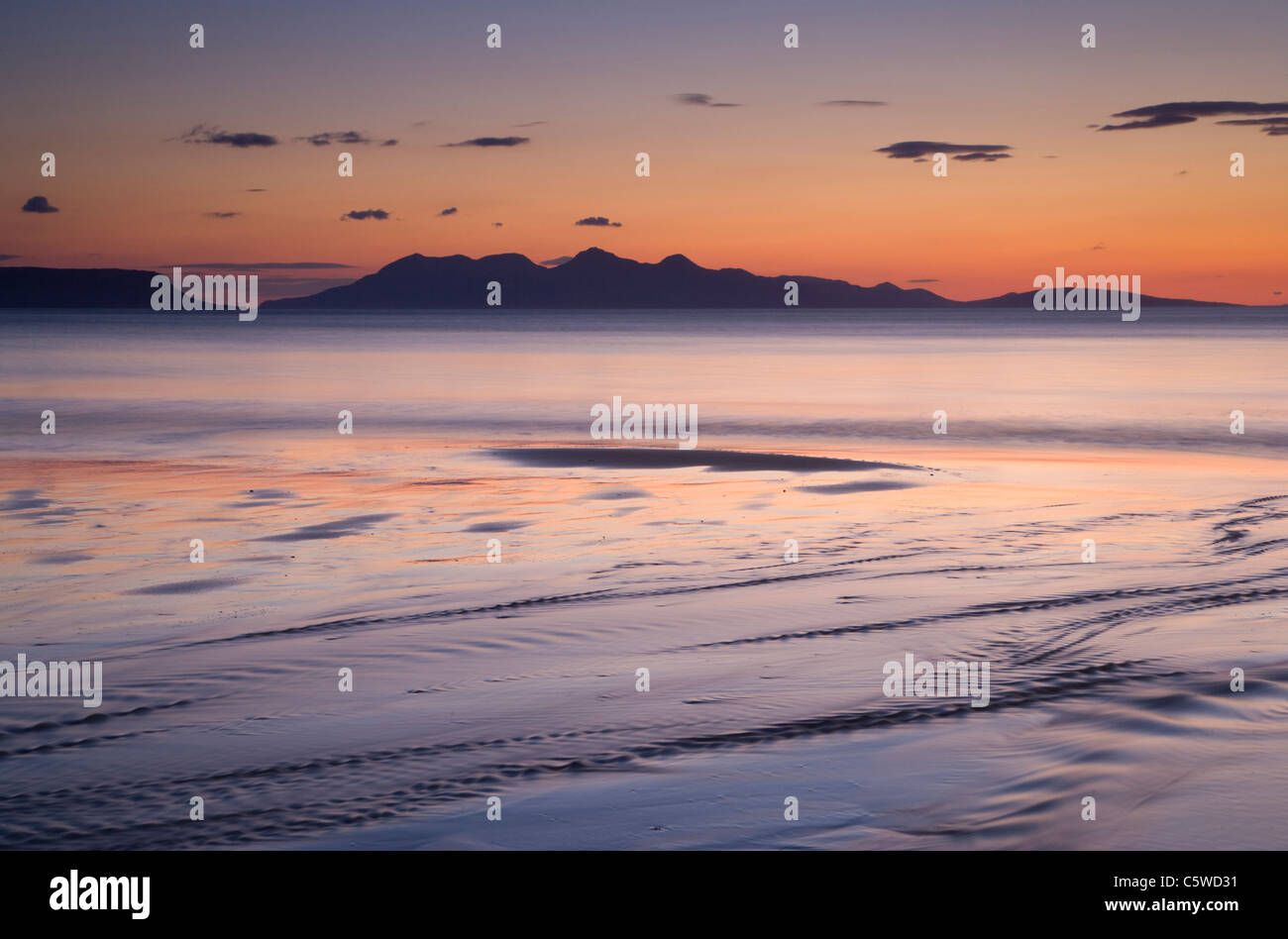 Arisaig Bay at sunset with view to Isle of Rum, North-west Scotland, Great Britain. - Stock Image