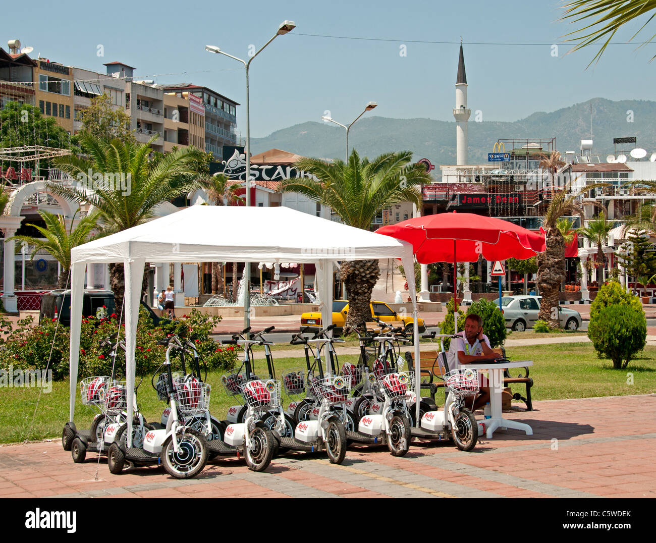 Alanya Town City Turkey Port scooter electric bike bicycle - Stock Image