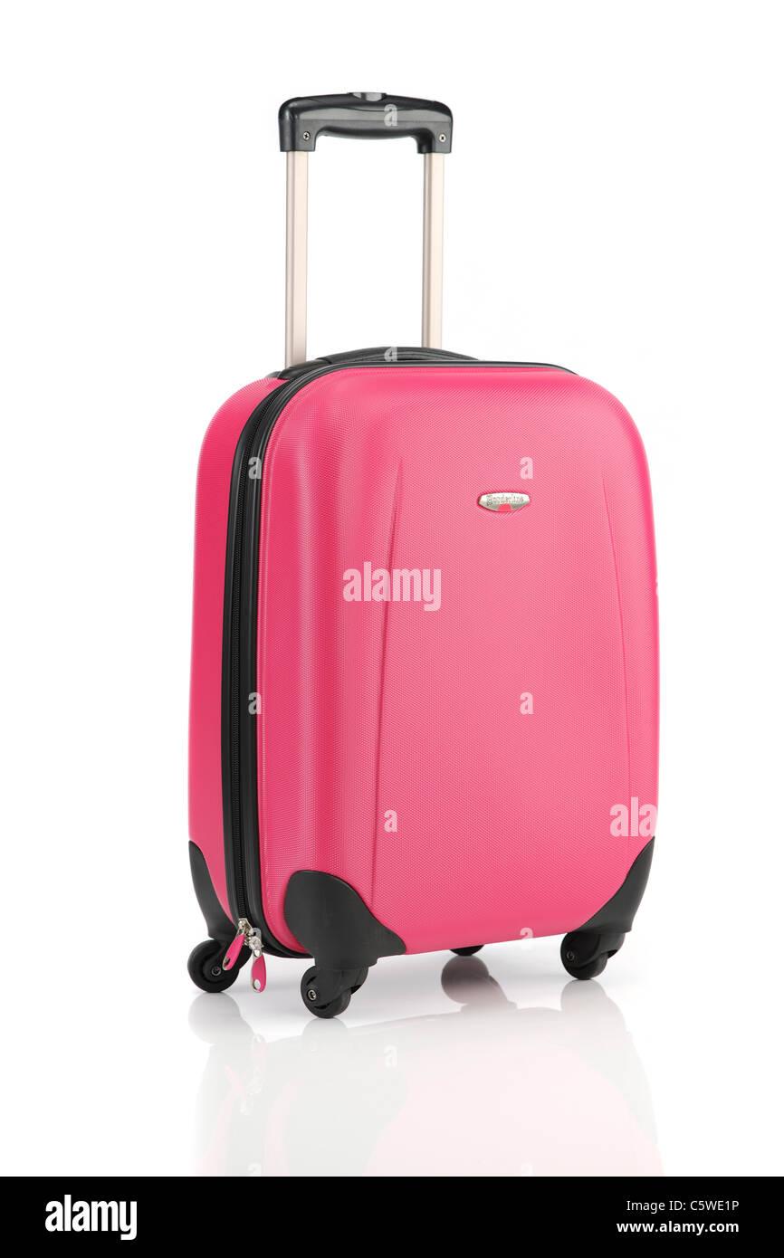 Pink Suitcase on white reflective background - Stock Image