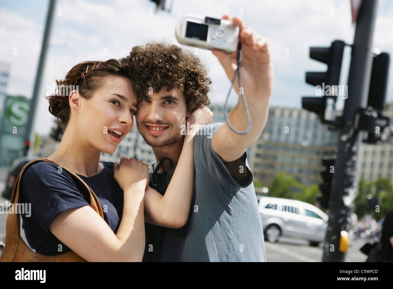 Germany, Berlin, Young couple taking a photograph of themselves - Stock Image