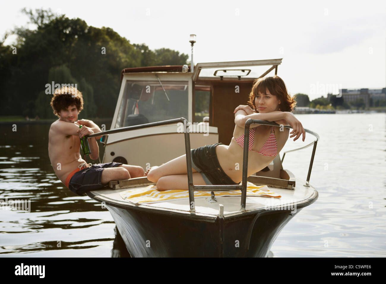 Germany, Berlin, Young couple on motor boat - Stock Image