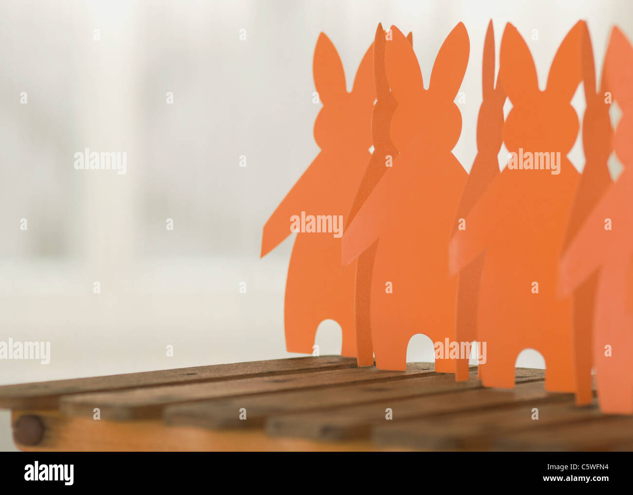 Paper garland of rabbit figurines, close-up - Stock Image