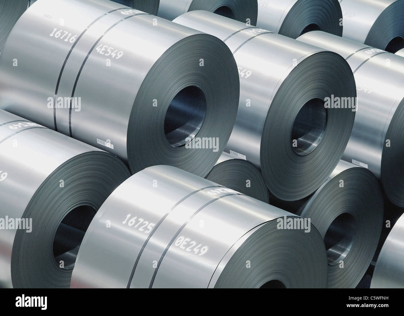 Germany, Stack of large rolls of sheet metal - Stock Image