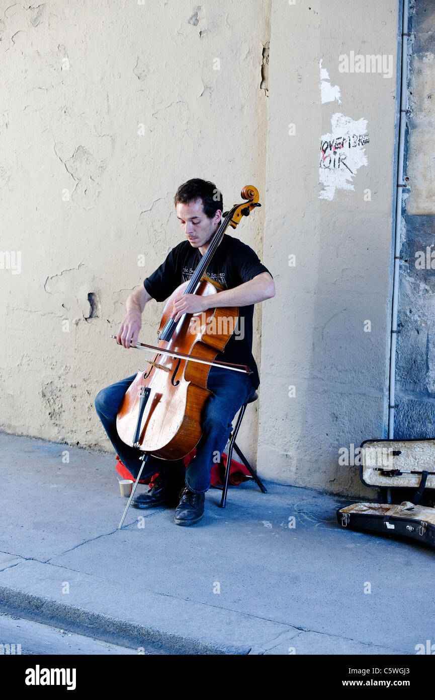 Cello playing busker in Paris, France - Stock Image