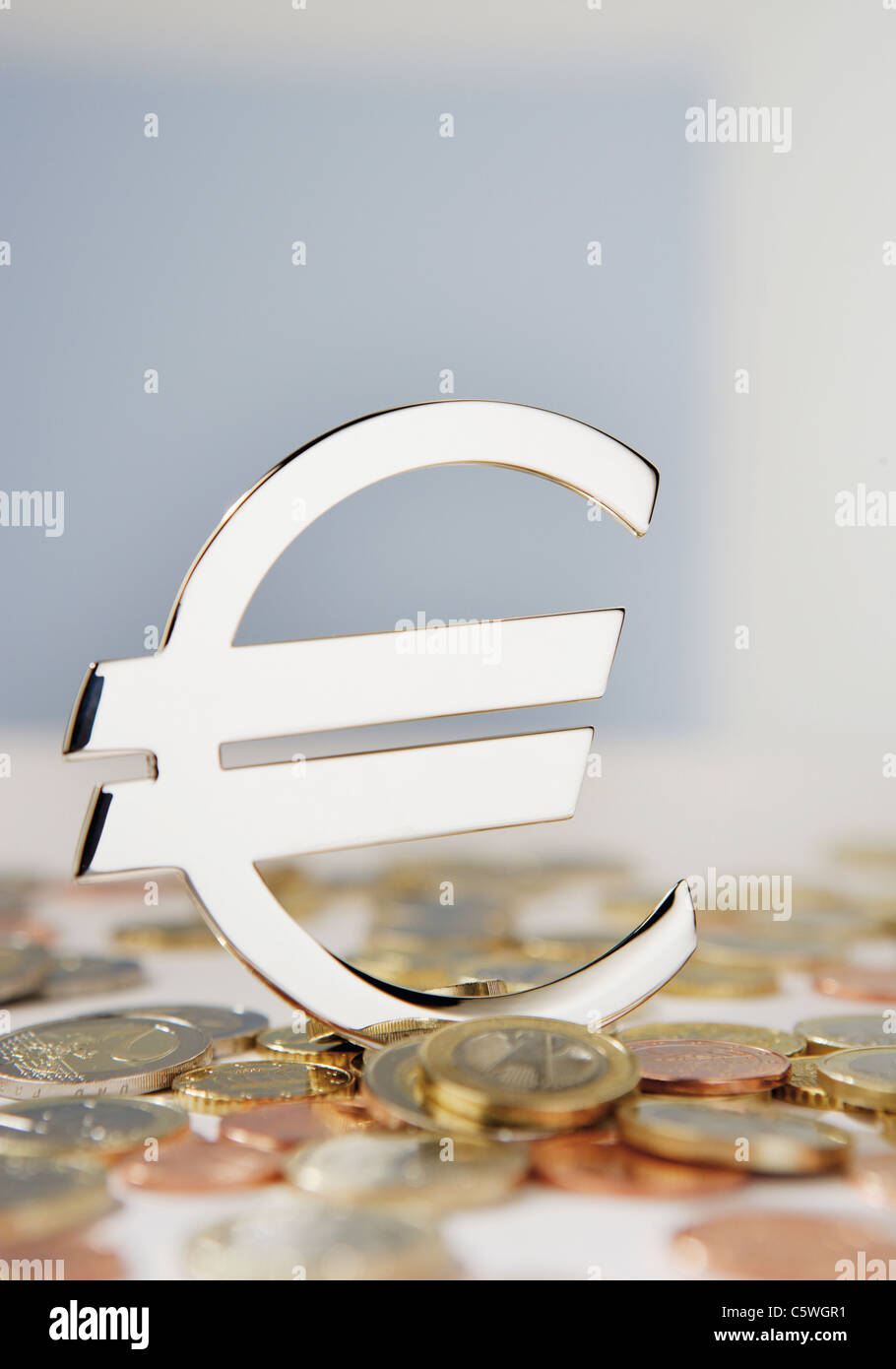 Close up of euro sign with euro coins - Stock Image