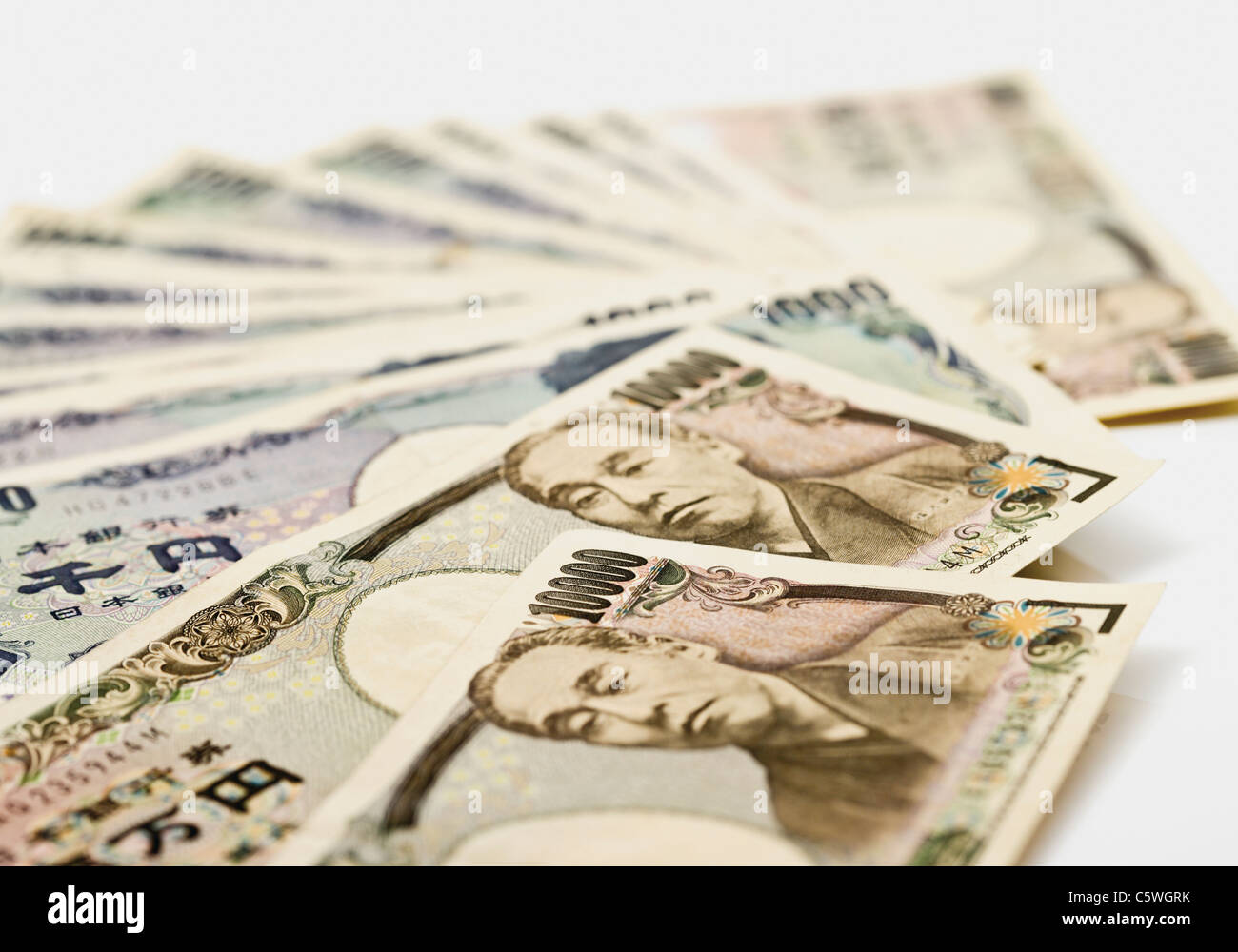 Japanese yen notes fanned out against white background - Stock Image