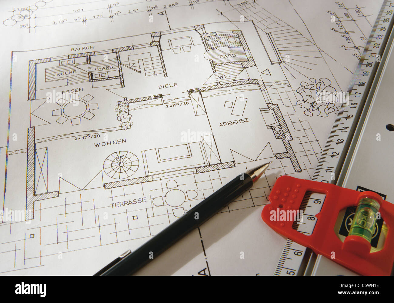 Blueprint with pen and tape measure, close up - Stock Image