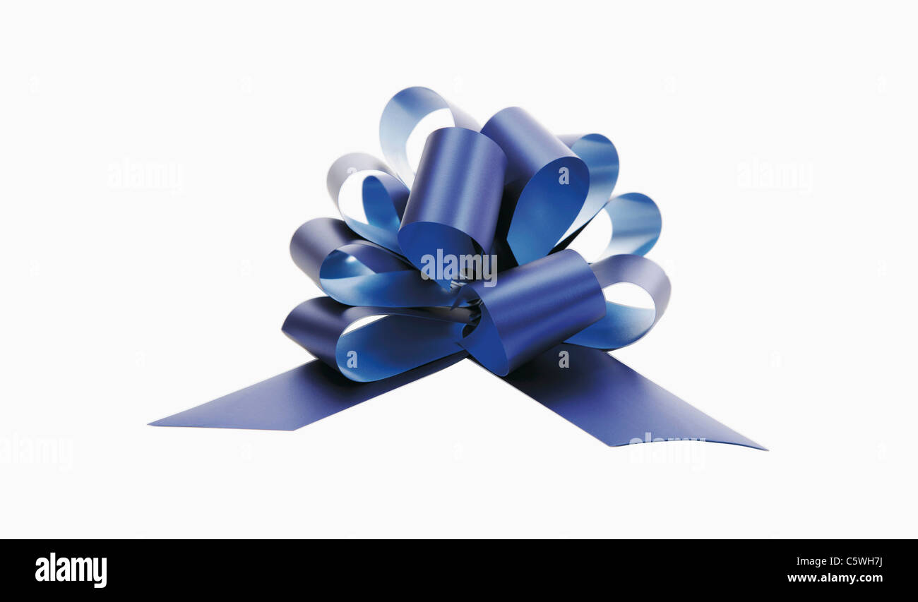 Gift ribbon against white background, close-up - Stock Image