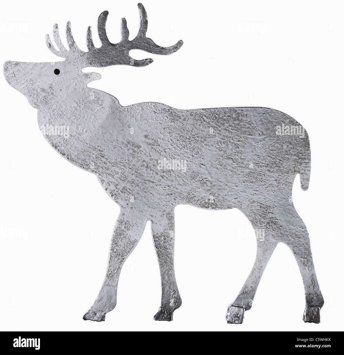 Metal sheet reindeer figurine against white background, close up - Stock Image