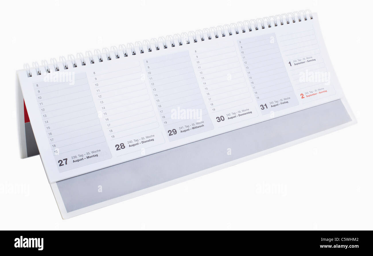 Small Desk Calendar Against White Background Close Up Stock Photo