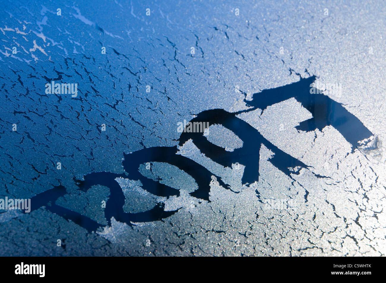 Germany, Stuttgart, 'Frost' written on frozen windscreen - Stock Image
