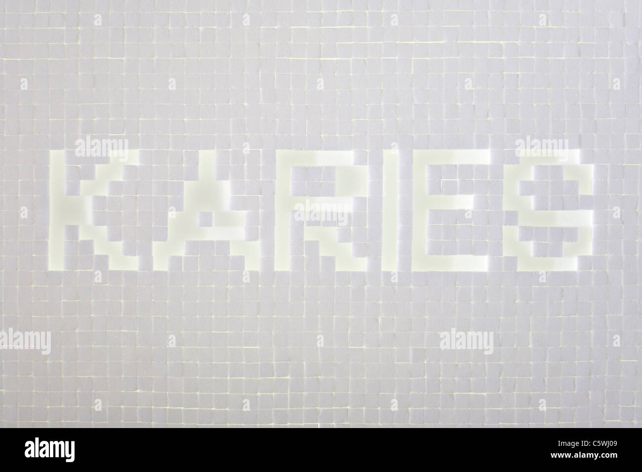 Sugar cubes forming the word Caries, elevated view - Stock Image