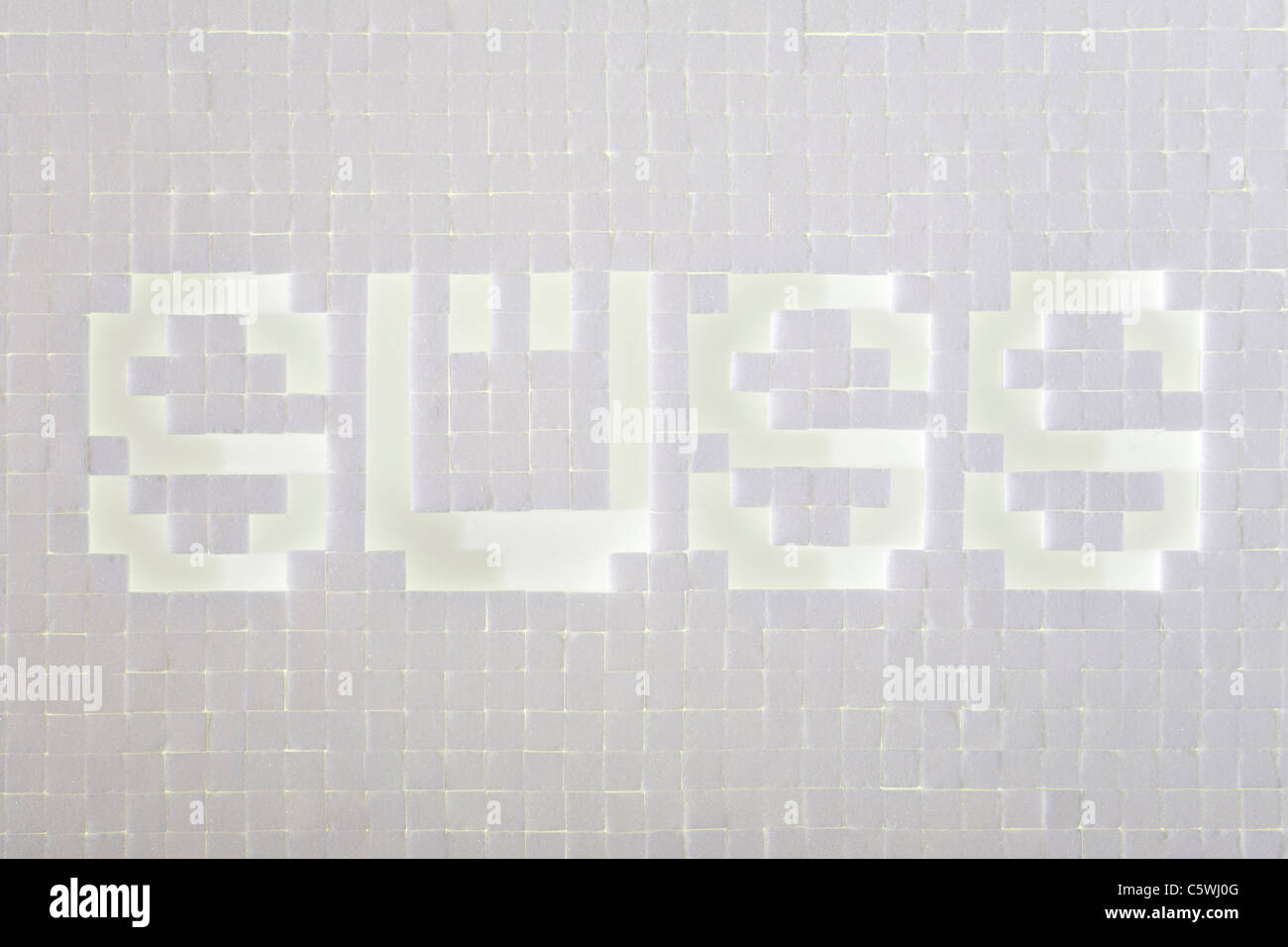 Sugar cubes writing the word sweet, elevated view - Stock Image