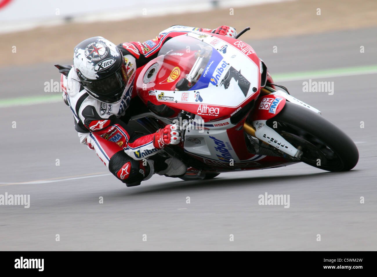 Race winner Carlos Checa exits Club during WSB race at Silverstone Stock Photo